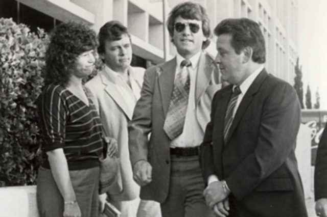 Mobster Anthony Spilitro, right, does the perp walk in 1983 following his racketeering arrest. He is accompanied, right to left, by FBI agent Mark Kaspar, while journalists George Knapp and Jane A ...