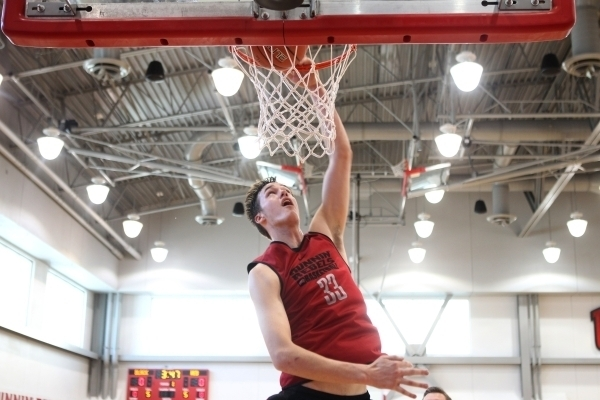 UNLV's Stephen Zimmerman Jr. (33) dunks the ball during a basketball team workout inside Mendenhall Center at UNLV in Las Vegas Thursday, Sept. 24, 2015. (Erik Verduzco/Las Vegas Review-Journal)