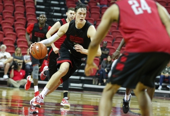 UNLV's Stephen Zimmerman (33) drives the ball during the Scarlet and Gray scrimmage at the Thomas & Mack Center in Las Vegas on Thursday, Oct. 15, 2015. (Chase Stevens/Las Vegas Review-Journal)