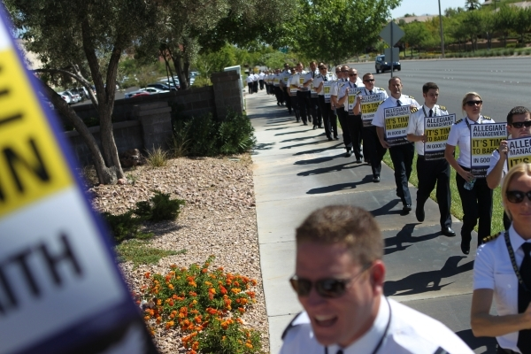 Allegiant Air pilots participate in a picket line outside of the   Allegiant Air headquarters, 1201 N. Town Center, in Las Vegas Tuesday, July 28, 2015. (Erik Verduzco/Las Vegas Review-Journal) Fo ...