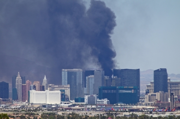 Smokes billows from a fire on an outside pool area of the Cosmopolitan Las Vegas hotel-casino in Las Vegas, Nevada July 25, 2015. The fire sent at least one person to the hospital and caused a par ...