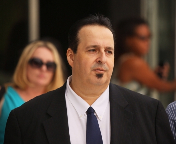 Leon Benzer, the mastermind of the scheme to take over and defraud HOAs in Southern Nevada, leaves the Lloyd D. George U.S. Courthouse on Thursday after being sentenced to 15 1/2  years in prison. ...