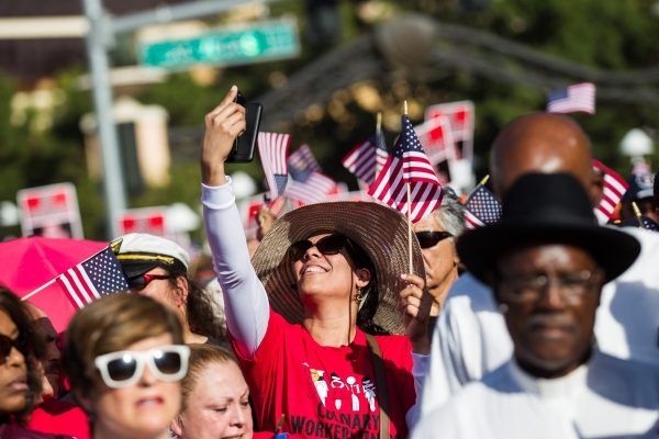 A woman takes a selfie as Culinary Union Local 226 members and supporters prepare to protest against the Trump International Hotel along Fashion Show Drive in Las Vegas on Friday, Aug. 21, 2015. C ...