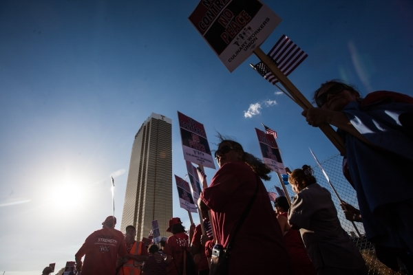 Culinary Union Local 226 members and supporters participate in a protest against the Trump International Hotel along Fashion Show Drive in Las Vegas on Friday, Aug. 21, 2015. Chase Stevens/Las Veg ...