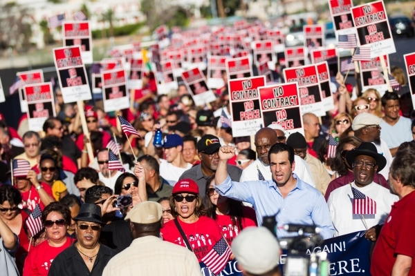 State Sen. Ruben Kihuen, bottom right in blue shirt, was among the protesters. Chase Stevens/Las Vegas Review-Journal