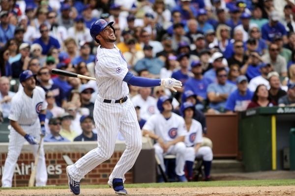 Chicago Cubs' Kris Bryant watches his walk off home run during the ninth inning of a baseball game against the Cleveland Indians on Monday, Aug. 24, 2015, in Chicago. The Cubs beat the India ...