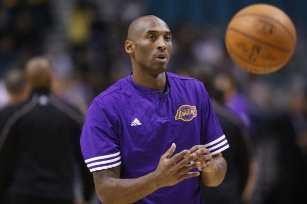 Los Angeles Lakers' Kobe Bryant (24) runs down the court in his preseason game against the Sacramento Kings at the MGM Grand Garden Arena in Las Vegas Tuesday, Oct. 13, 2015. (Erik Verduzco/ ...