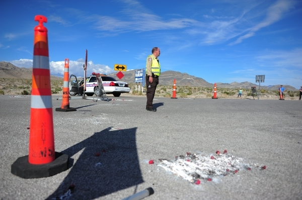 Nye County Sheriff and NHP officers divert traffic from U.S. Highway 95 to Nevada State Route 160 on Monday, Oct. 19, 2015, north of Las Vegas. Brett LeBlanc/Las Vegas Review-Journal Follow @blebl ...