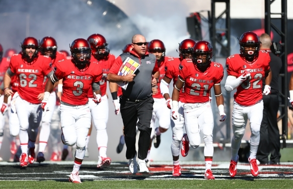 UNLV head coach Tony Sanchez runs out with the team before playing against Boise State during a football game at Sam Boyd Stadium in Las Vegas on Saturday, Oct. 31, 2015. Chase Stevens/Las Vegas R ...