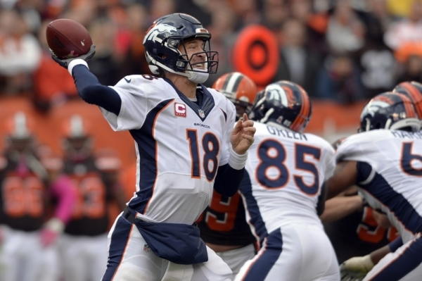 Oct 18, 2015; Cleveland, OH, USA; Denver Broncos quarterback Peyton Manning (18) throws a pass during the second half against the Cleveland Browns at FirstEnergy Stadium. The Broncos won 26-23. Ma ...