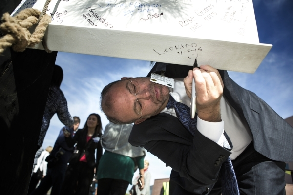 Leonard Freehof, CEO of Spring Valley Hospital, 5400 S. Rainbow Boulevard, signs a beam during the  ceremonial topping off event at on Thursday, November 5, 2015. The four-story addition will add  ...