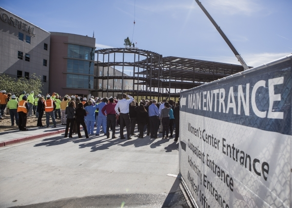 People gather to watch the ceremonial topping off event at Spring Valley Hospital, 5400 S. Rainbow Boulevard, on Thursday, November 5, 2015. The four-story addition will add 144 beds to the existi ...