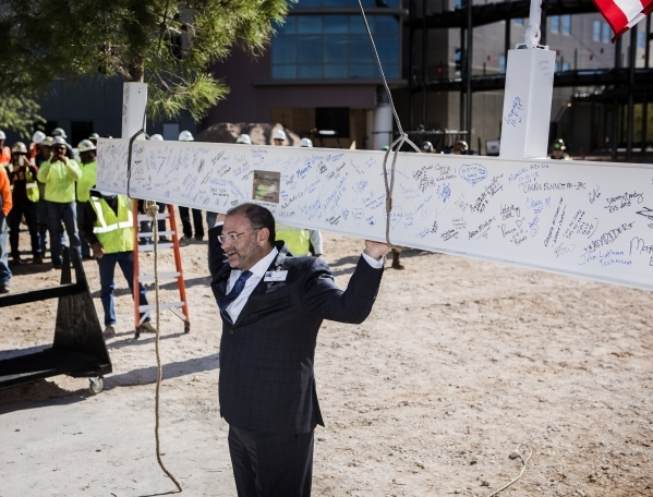 Leonard Freehof, CEO of Spring Valley Hospital, 5400 S. Rainbow Boulevard, pretends to be lifting an signed beam during the  ceremonial topping off event at on Thursday, November 5, 2015. The four ...