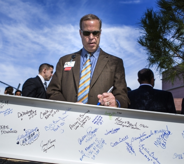 Scott Rommey, senior system director of Spring Valley Hospital, 5400 S. Rainbow Boulevard, signs a beam during the  ceremonial topping off event at on Thursday, November 5, 2015. The four-story ad ...