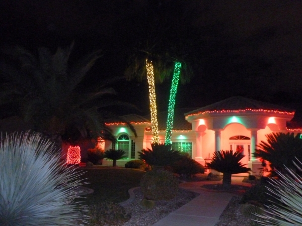 A green-and-red theme dominates the exterior lighting decor of this house.  COURTESY COURTNEY LIGHTS