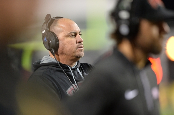 UNLV head coach Tony Sanchez watches his team play during the San Diego State at UNLV game at Sam Boyd Stadium on Saturday, November 21, 2015, in Las Vegas. San Diego State won the game, 52-14. Br ...