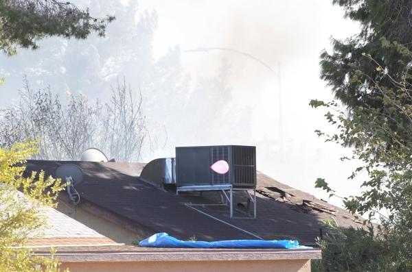 Smoke is seen from a burning house near Lamb Boulevard and Sherrill Avenue, Monday, Nov. 16, 2015. Bizuayehu Tesfaye/Las Vegas Review-Journal Follow @bizutesfaye