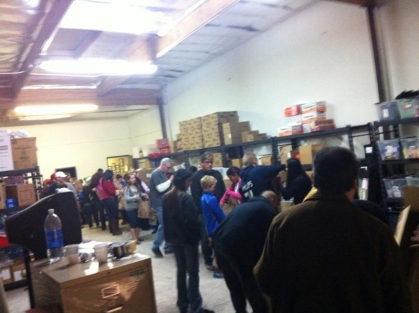 Project 150 members work on assembling food packages in this undated photo. On Nov. 26, 2015, the group worked to ensure at least 1,500 local high school students and their families had a Thanksgi ...