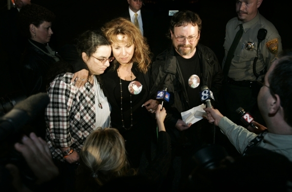 Family members of murder victim Betty Jane May answer media questions outside Nevada State Prison in Carson City, Nev., on Wednesday night, April 26, 2006, following the execution of her killer, D ...