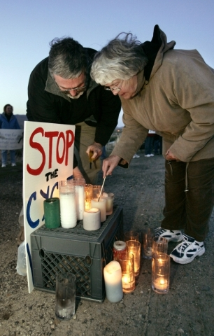 Joe Reville and Sister Marie of St. Teresa of Avila Catholic Church light candles at a protest in front of the Nevada State Prison in Carson City, Nev. on Wednesday night, April 26, 2006, during c ...