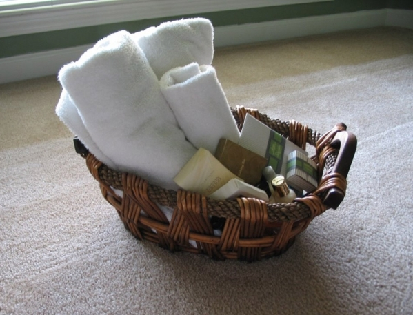 A decorative basket can be used to hold towels and toiletries for guests. COURTESY