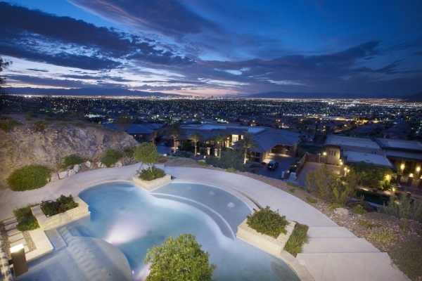 The home's pool at night. COURTESY