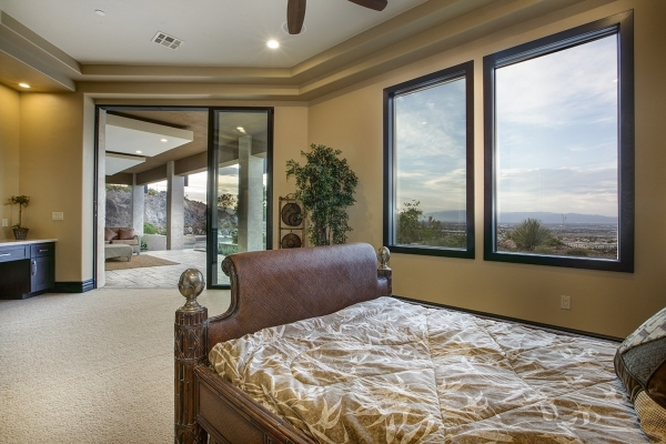 Several of the bedrooms open to the second-story balcony. COURTESY