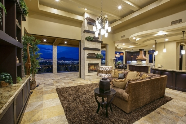 The home at 1504 View Field Court in MacDonald Highlands features a living room with views of the Las Vegas Valley. It's listed at nearly $3.9 million. COURTESY