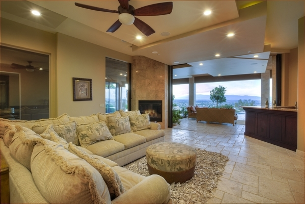 The home has an entertainment area with a balcony. COURTESY