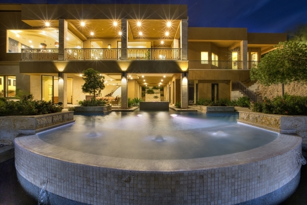 The two-level home has a pool. COURTESY
