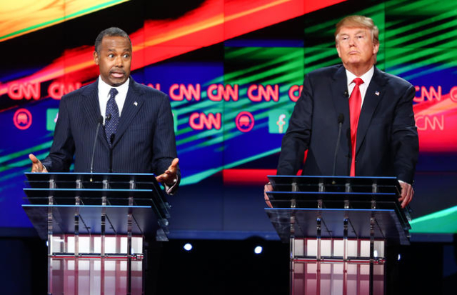 Ben Carson, left, speaks as Donald Trump looks on during the CNN Republican presidential debate at the Venetian hotel-casino in Las Vegas on Tuesday, Dec. 15, 2015. Chase Stevens/Las Vegas Review- ...