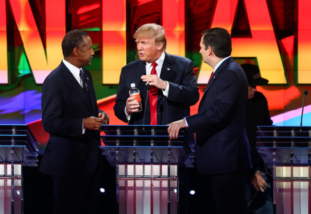 Ben Carson, from left, Donald Trump and Ted Cruz talk between a break during the CNN Republican presidential debate at the Venetian hotel-casino in Las Vegas on Tuesday, Dec. 15, 2015. Chase Steve ...