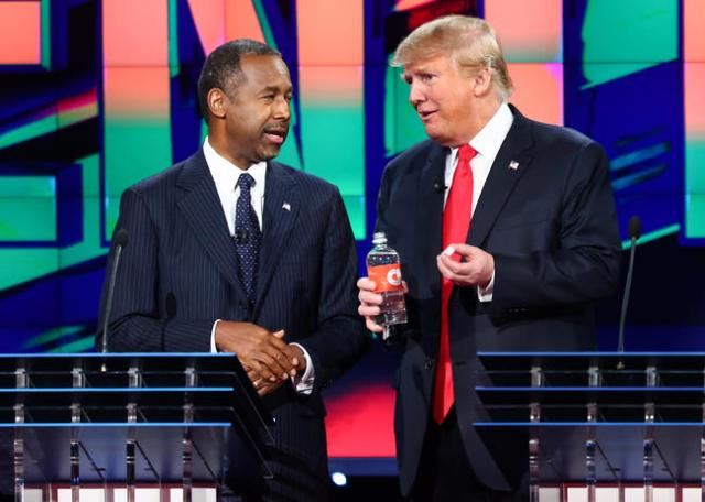 Ben Carson, left, and Donald Trump talk between a break during the CNN Republican presidential debate at the Venetian hotel-casino in Las Vegas on Tuesday, Dec. 15, 2015. Chase Stevens/Las Vegas R ...