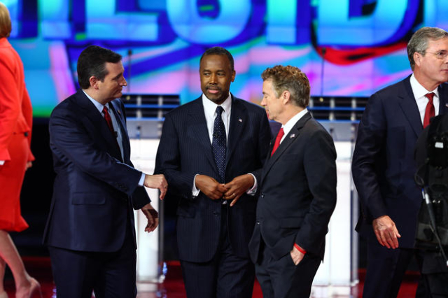 Republican presidential candidates, from left, Ted Cruz, Ben Carson and Rand Paul talk following the CNN Republican presidential debate at the Venetian hotel-casino in Las Vegas on Tuesday, Dec. 1 ...