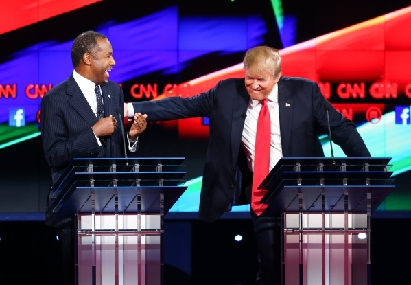 Ben Carson, left, and Donald Trump share a laugh during the CNN Republican presidential debate at the Venetian hotel-casino in Las Vegas on Tuesday, Dec. 15, 2015. Chase Stevens/Las Vegas Review-J ...