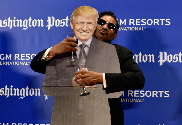 Derek Washington poses with a cardboard cut out of GOP presidential candidate Donald Trump during Washington Post's 2016 Pregame at the MGM Grand on Monday, Dec. 14, 2015, in Las Vegas. Davi ...