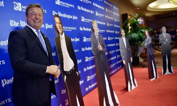 "U.S. Sen. Dean Heller, R-Nev., left, poses next to ""his man"" on the red carpet as he arrived at the Washington Post's 2016 Pregame at the MGM Grand on Monday, Dec. 14, 2015, in Las ..."
