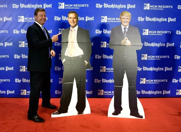 """U.S. Sen. Dean Heller, R-Nev., left, poses next to """"his man"""" on the red carpet as he arrived at the Washington Post's 2016 Pregame at the MGM Grand on Monday, Dec. 14, 2015, in Las ..."""