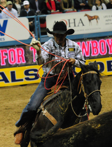 Team ropers Junior Nogueira from Scottsdale, Ariz., lassos a calf during the first go-round of the 2015 Wrangler National Finals Rodeo at the Thomas & Mack Center in Las Vegas  Thursday, Dec.  ...
