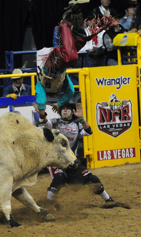 Bull rider Dustin Bowen from Waller, Texas, is bucked from his bull during the first go-round of the 2015 Wrangler National Finals Rodeo at the Thomas & Mack Center in Las Vegas  Thursday, Dec ...