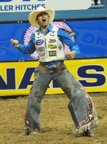 Saddle bronc rider Heath DeMoss from Heflin, La., celebrates his second place score of 86 during the first go-round of the 2015 Wrangler National Finals Rodeo at the Thomas & Mack Center in La ...