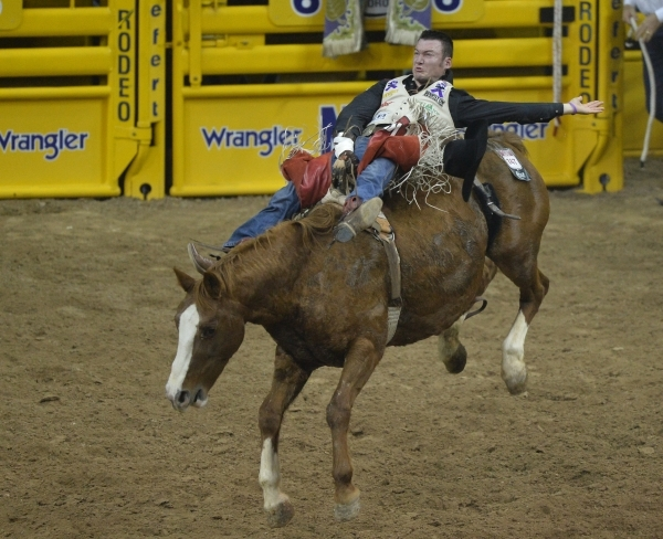 Steven Peebles, of Redmond, Ore., rides Beaver Fever in the Bareback Riding competition on the second day of the 2015 Wrangler National Finals Rodeo at the Thomas & Mack Center in Las Vegas on ...