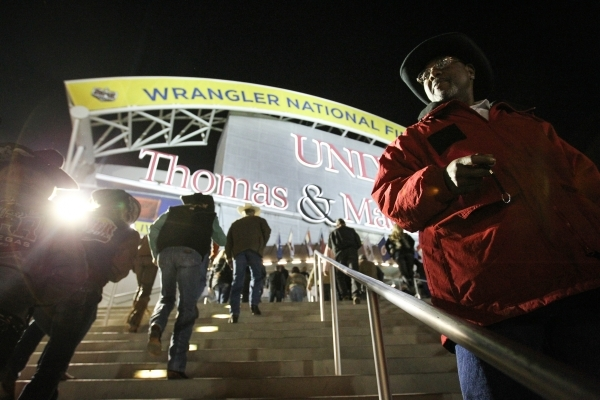 Austin Foss, of Terrebonne, Ore., rides Soap Bubbles in the Bareback Riding competition on the second day of the 2015 Wrangler National Finals Rodeo at the Thomas & Mack Center in Las Vegas on ...