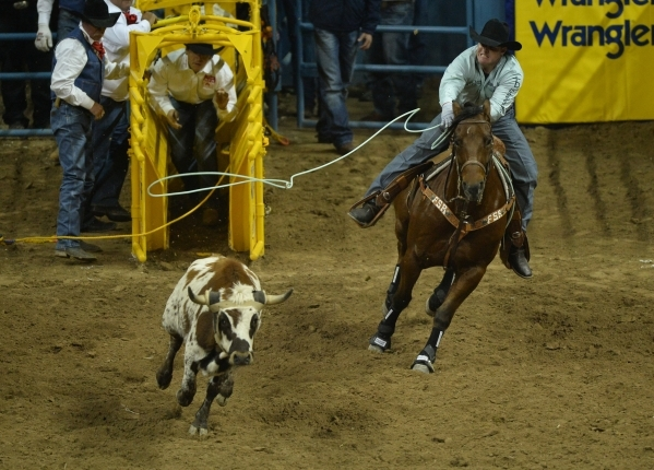 Jake Cooper, of Monument, N.M., lassos a steer in the team roping competition on the second day of the 2015 Wrangler National Finals Rodeo at the Thomas & Mack Center in Las Vegas on Friday, D ...