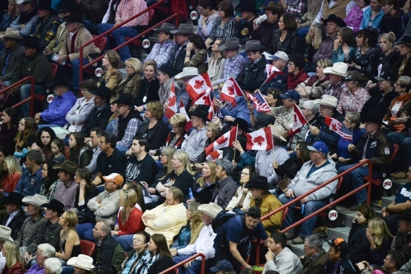 Fans wave Canadian flags on the second day of the 2015 Wrangler National Finals Rodeo at the Thomas & Mack Center in Las Vegas on Friday, Dec. 04, 2015. Brett Le Blanc/Las Vegas Review-Journal ...