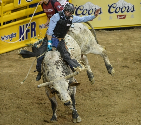 Clayton Foltyn, of Winnie, Texas, rides Thunderstruck in the Bull Riding competition on the second day of the 2015 Wrangler National Finals Rodeo at the Thomas & Mack Center in Las Vegas on Fr ...