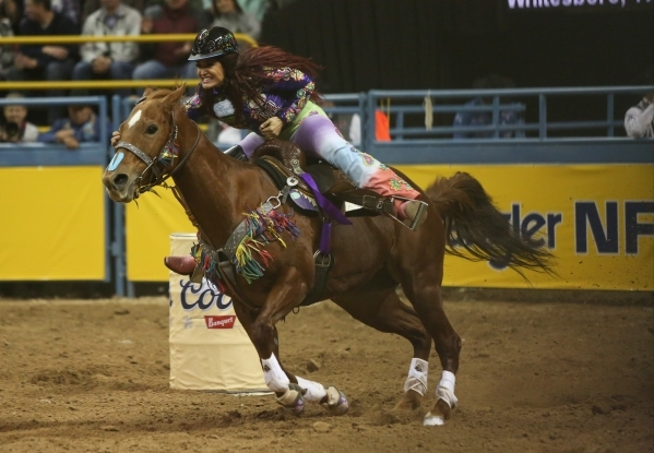Fallon Taylor, of Whitesboro, Texas, competes in the Barrel Racing competition on the second day of the 2015 Wrangler National Finals Rodeo at the Thomas & Mack Center in Las Vegas on Friday,  ...