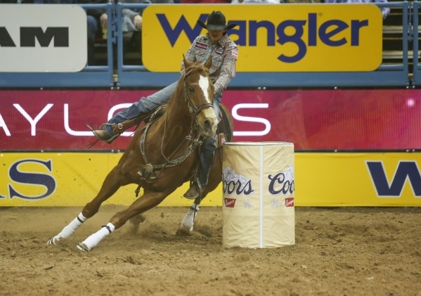 Nancy Hunter, of Neola, Utah, competes in the Barrel Racing competition on the second day of the 2015 Wrangler National Finals Rodeo at the Thomas & Mack Center in Las Vegas on Friday, Dec. 04 ...