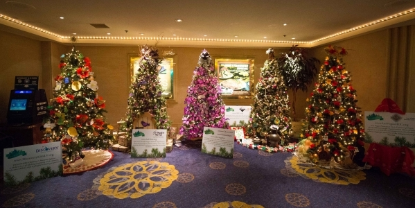 Trees of Hope are shown on display at the California Hotel, 12 E. Ogden Ave., by, from left, the Discovery Chldren's Museum, Safe Next, the Desert Southwest Chapter of the Alzheimer's  ...
