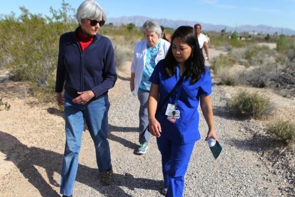 Cheryl Keown, left, walks with University Medical Center transplant Chris Josim, registered nurse coordinator, during the University Medical Center and Springs Preserve-sponsored event Walk with a ...